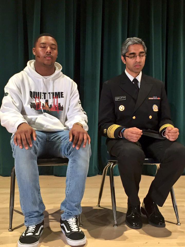 Surgeon General Vivek Murthy meditates with a student